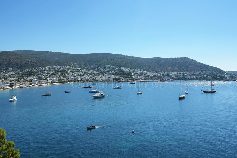 Aegean sea, Bay of Bodrum, Turkey. Blue sea with yachts and boats. Gorgeous Gumbet Bay situated on the Aegean sea royalty free stock photo