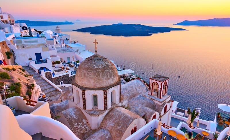 Aegean sea and Thira town at sundown royalty free stock image