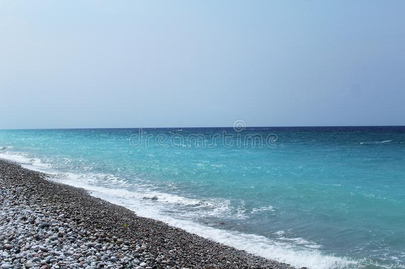 Aegean seascape: turquoise blue sea and rocky beach stock photography