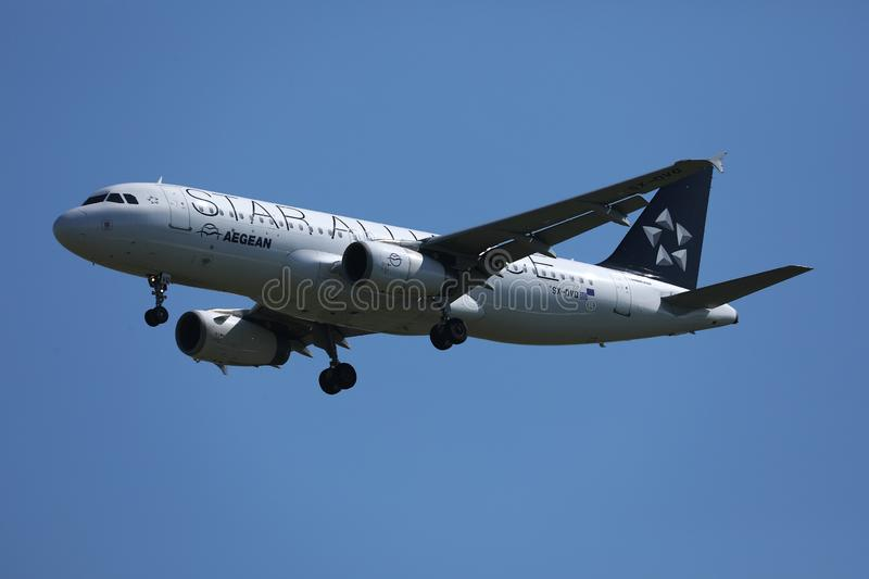 Aegean Star Alliance Livery plane flying in the sky. Aegean Star Alliance Livery plane flying up in the sky stock image