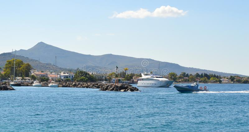 Aegina port in Aegina island, Greece on June 19, 2017. AEGINA, GREECE - JUNE 19: Aegina port in Aegina island, Greece on June 19, 2017 royalty free stock images