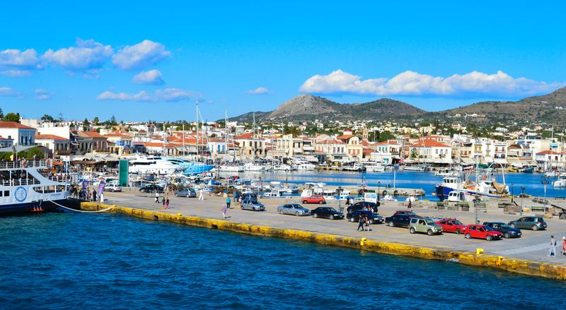 Aegina port in Aegina island, Greece on June 19, 2017. AEGINA, GREECE - JUNE 19: Aegina port in Aegina island, Greece on June 19, 2017 stock image
