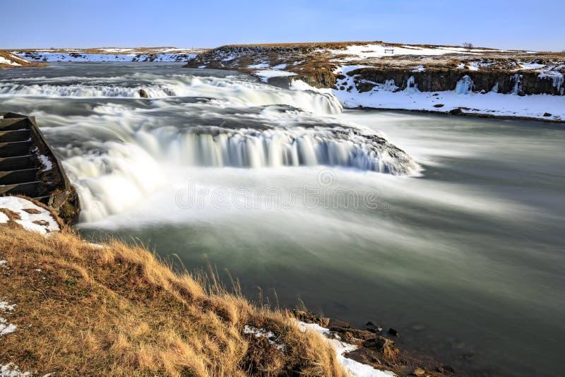 AEgissíðufoss vattenfall nära Hella på väg 1, Island under vintersäsongen royaltyfria bilder