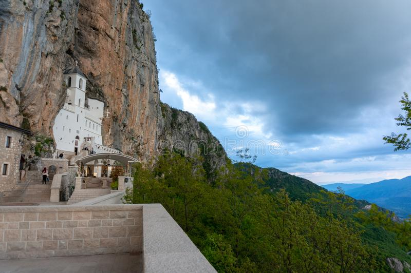 Monastery of Ostrog is a monastery of Serbian Orthodox Church placed against an almost vertical rock of Ostroska Greda stock image