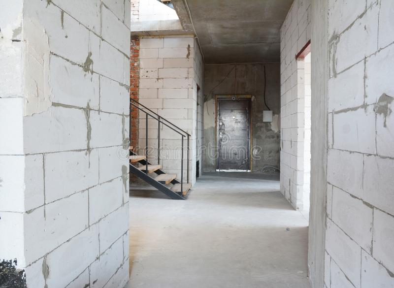 Aerated concrete blocks house corridor walls under construction ready for plastering and stucco. Photo royalty free stock photos
