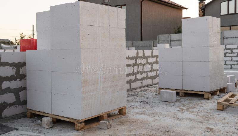 Aerated concrete blocks on a pallet. At a construction site. House royalty free stock photography