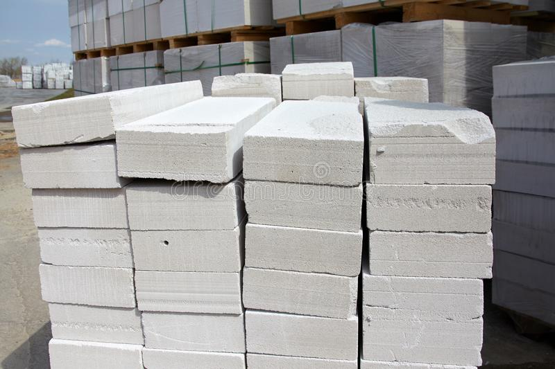 Aerated concrete blocks on pallets stored at warehouse.  stock image