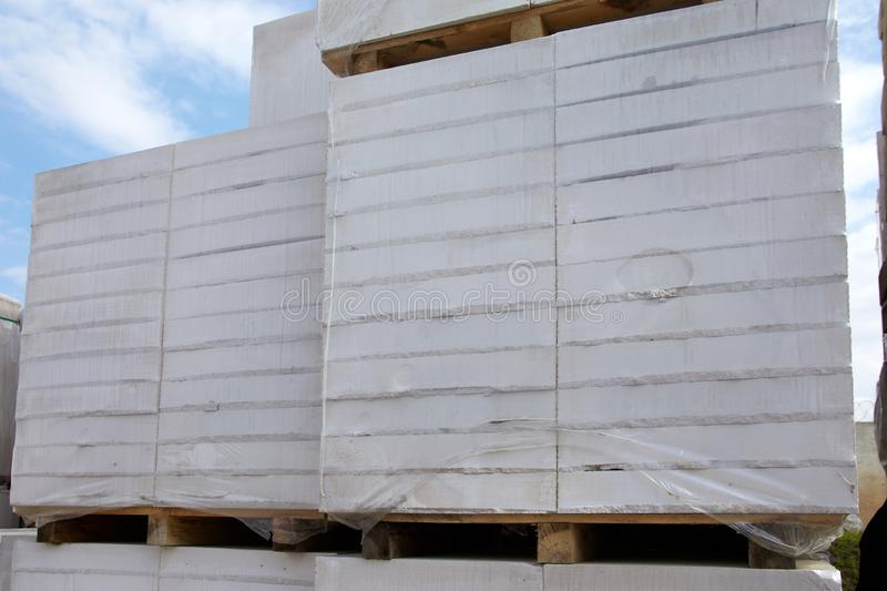 Aerated concrete blocks on pallets stored at warehouse.  royalty free stock image