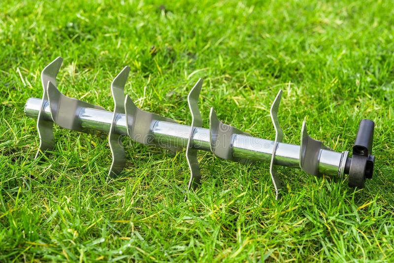 Aerating roller on the grass stock photo
