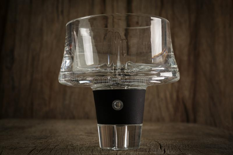 Aerator. Glass aerator on wooden background stock images