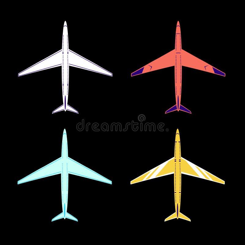 4 aerei dei colori bianchi, rossi, blu e gialli immagini stock libere da diritti