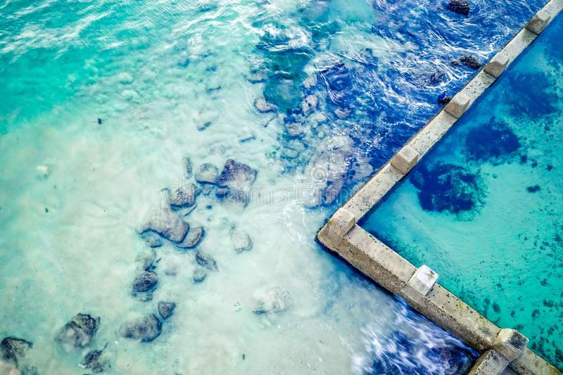 Aerial abstract of ocean and rock pool. Of Coogee Beach Australia.  Space for copy stock image