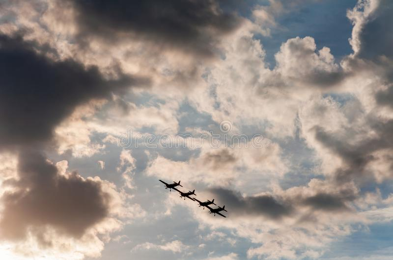 Aerial acrobatics exhibition. Aerobatics planes flying in the sky with clouds in the background royalty free stock photos