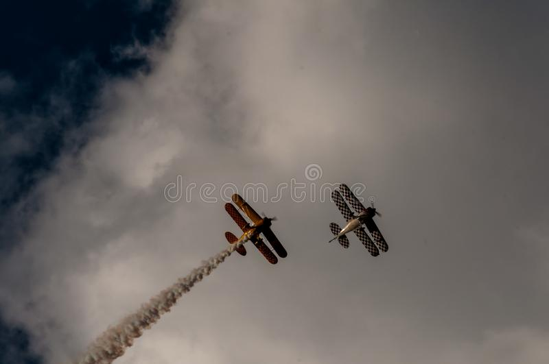 Aerial acrobatics exhibition. Aerobatics planes flying in the sky with clouds in the background stock photo