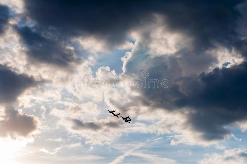 Aerial acrobatics exhibition. Aerobatics planes flying in the sky with clouds in the background stock image