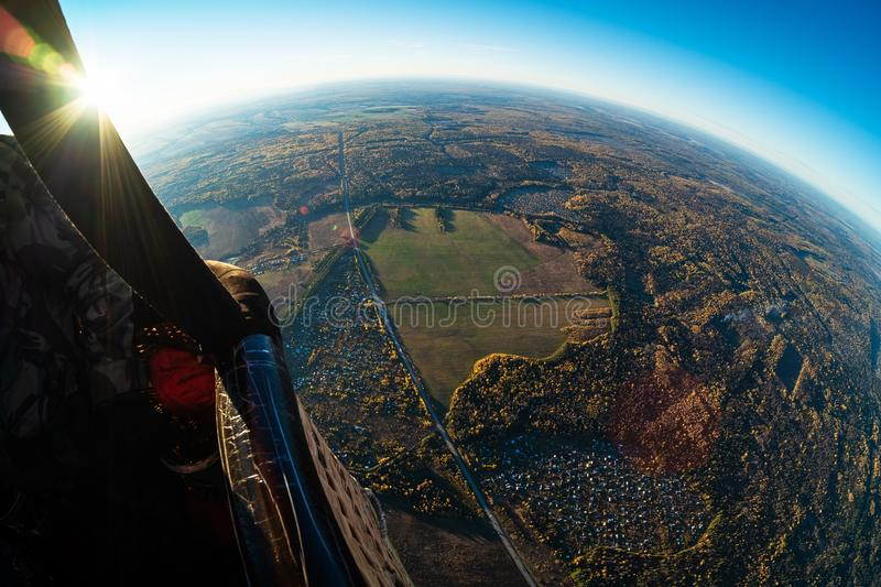Aerostat flying. Aerial, aerostat view of the suburban area of the city of Izhevsk with roads, villages and autumn forest. Russia stock photography