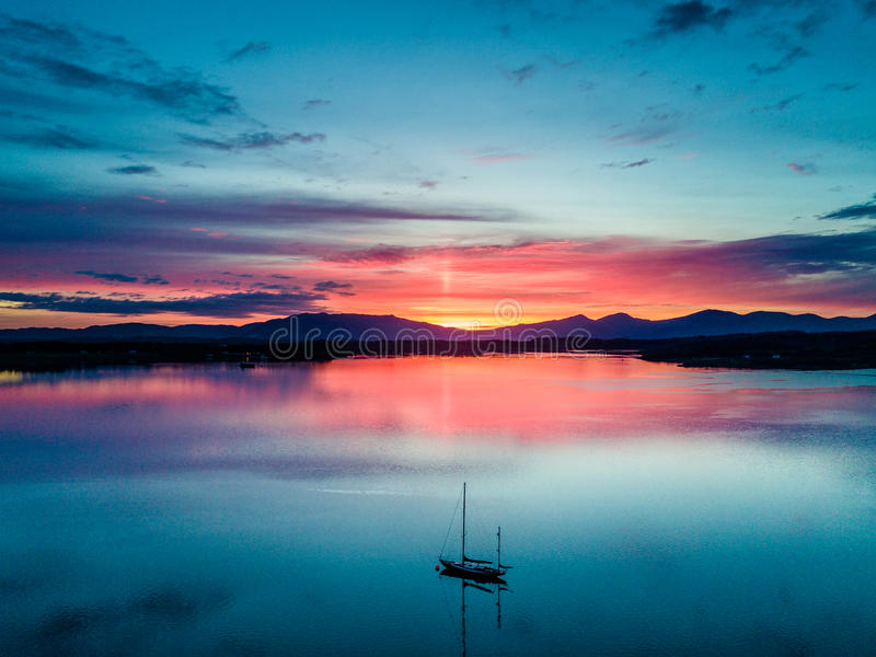 Aerial of an amazing sunset with sailing vessel Loch Creran, Barcaldine, Argyll royalty free stock images