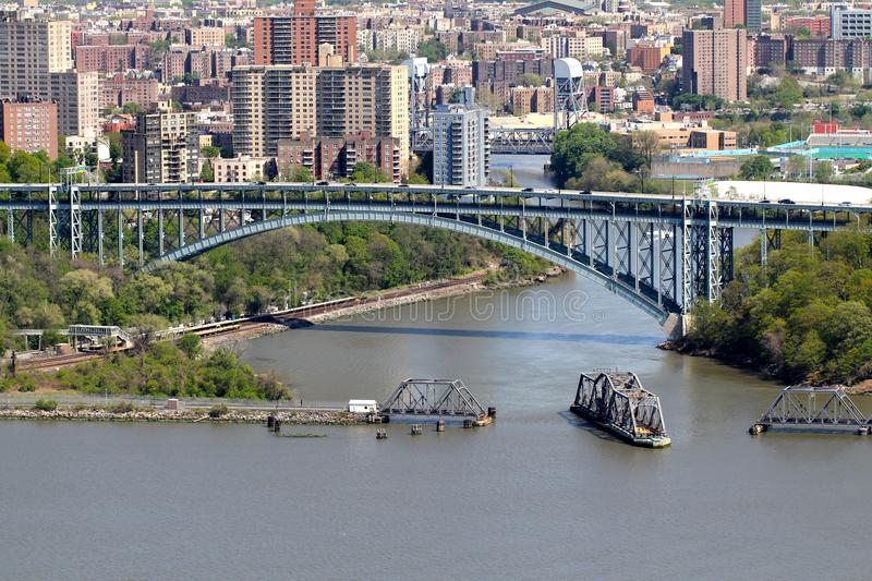 Aerial Amtrak Spuyen Duyvil Railroad Swing Bridge. The AMTRAK railroad swing bridge at Spuyten Duyvil, the northern tip of Manhattan island, in open position to royalty free stock photos