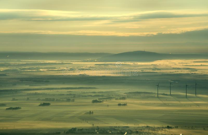 Aerial beautiful sunrise arriving to Vienna from the Airplane, Austria royalty free stock photo
