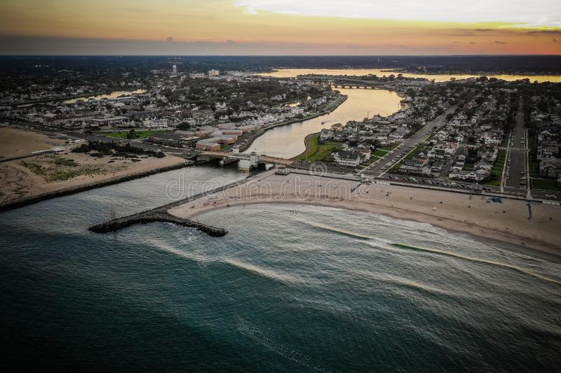 Aerial of Belmar Beach Sunset New Jersey. Aerial of Belmar Beach New Jersey. This is a popular destination for locals to come for sun bathing, surfing, fishing stock photos