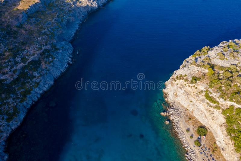 Aerial bird`s eye view photo taken by drone of famous beach of Anthony Quinn with clear water rocky seascape, Rhodes island, stock photos