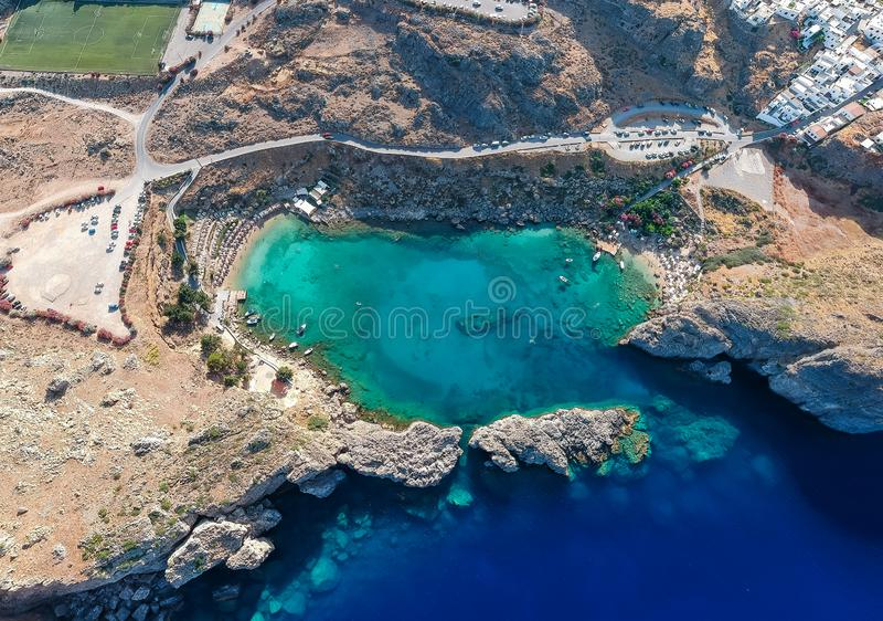 Aerial birds eye view drone photo Saint Paul bay near village Lindos, Rhodes island, Dodecanese, Greece. Sunny panorama with royalty free stock photography