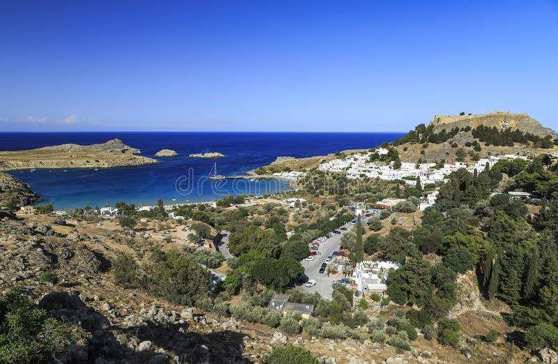 Aerial birds eye view on Saint Paul bay near village Lindos, Rhodes island. Sunny panorama with lagoon and clear blue water. Famous tourist destination in royalty free stock photography