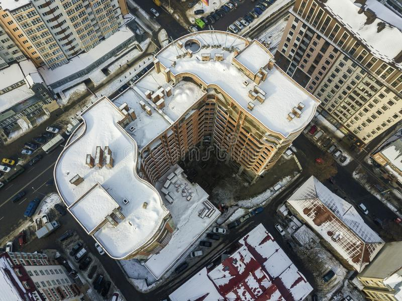Aerial black and white winter panoramic top view of modern city with tall apartment complex buildings snowy roof, parked and. Moving cars along streets. Urban royalty free stock photos