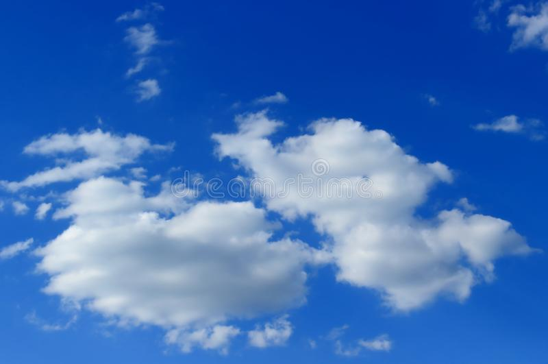 Blue sky and fluffy clouds royalty free stock photography