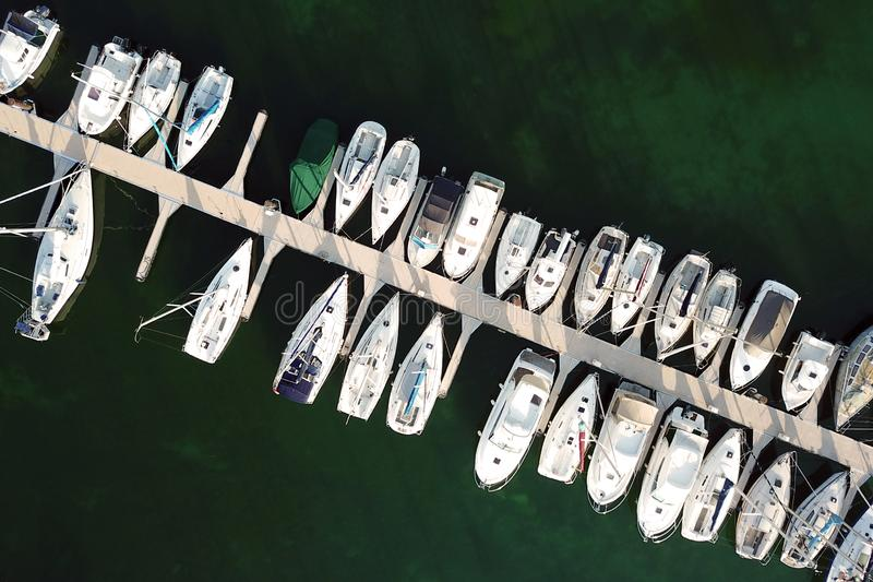 Aerial of boats parked in port stock images