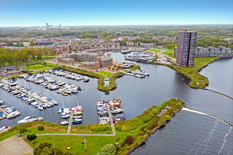 Aerial from the city and harbour in Almere in Netherlands. Aerial from the city and harbour in Almere in the Netherlands stock photography