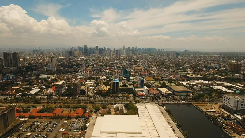Aerial city with skyscrapers and buildings. Philippines, Manila, Makati. Aerial view of Manila city. Fly over city with skyscrapers and buildings. Aerial royalty free stock photos