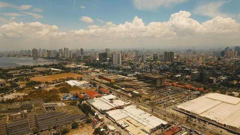 Aerial city with skyscrapers and buildings. Philippines, Manila, Makati. Aerial view of Manila city. Fly over city with skyscrapers and buildings. Aerial stock photography
