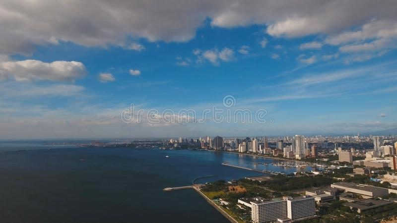 Aerial city with skyscrapers and buildings. Philippines, Manila, Makati. Aerial view skyline of Manila city, Makati. Fly over city with skyscrapers and royalty free stock photography