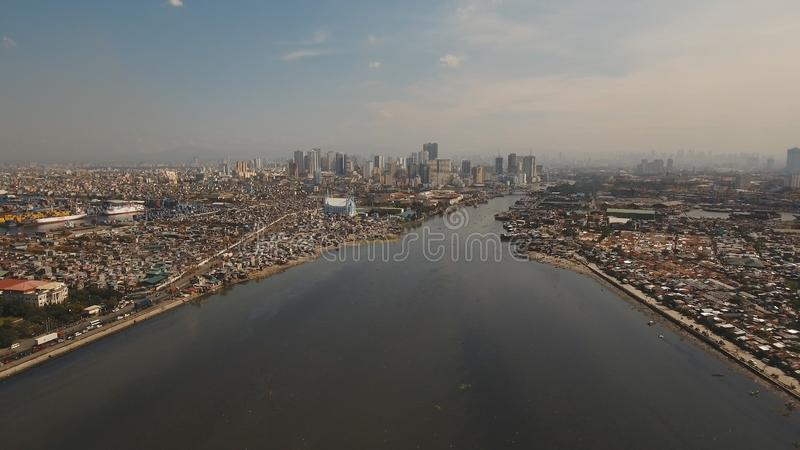 Aerial city with skyscrapers and buildings. Philippines, Manila, Makati. Aerial view skyline of Manila city. Fly over city with skyscrapers and buildings stock photo