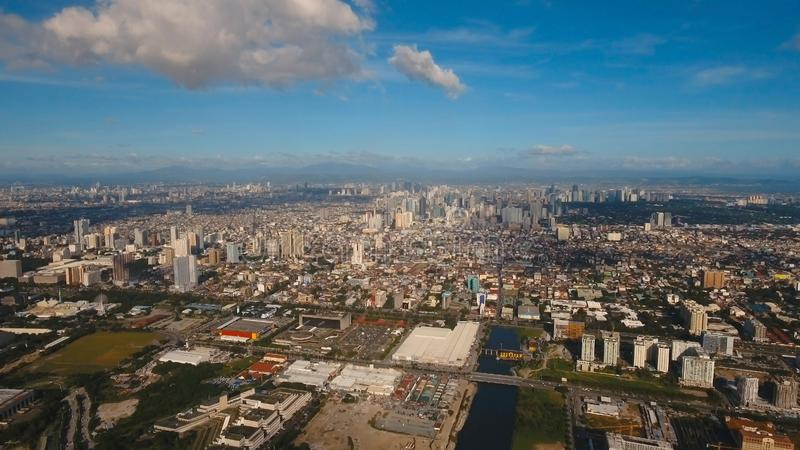 Aerial city with skyscrapers and buildings. Philippines, Manila, Makati. Aerial view skyline of Manila city, Makati. Fly over city with skyscrapers and royalty free stock photo