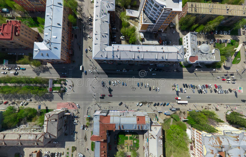 Aerial city view with crossroads and roads, houses buildings. Copter shot. Panoramic image. Aerial city view with crossroads and roads, houses, buildings, parks royalty free stock photography