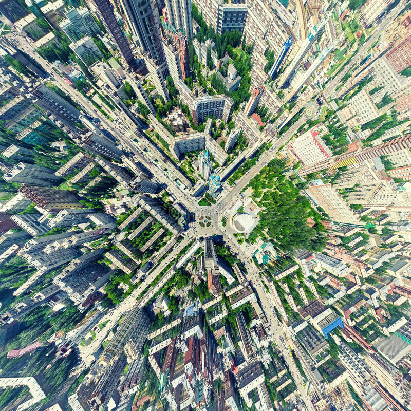 Aerial city view. Urban landscape. Copter shot. Panoramic image. Aerial city view with crossroads and roads, houses, buildings, parks and parking lots, bridges royalty free stock photography