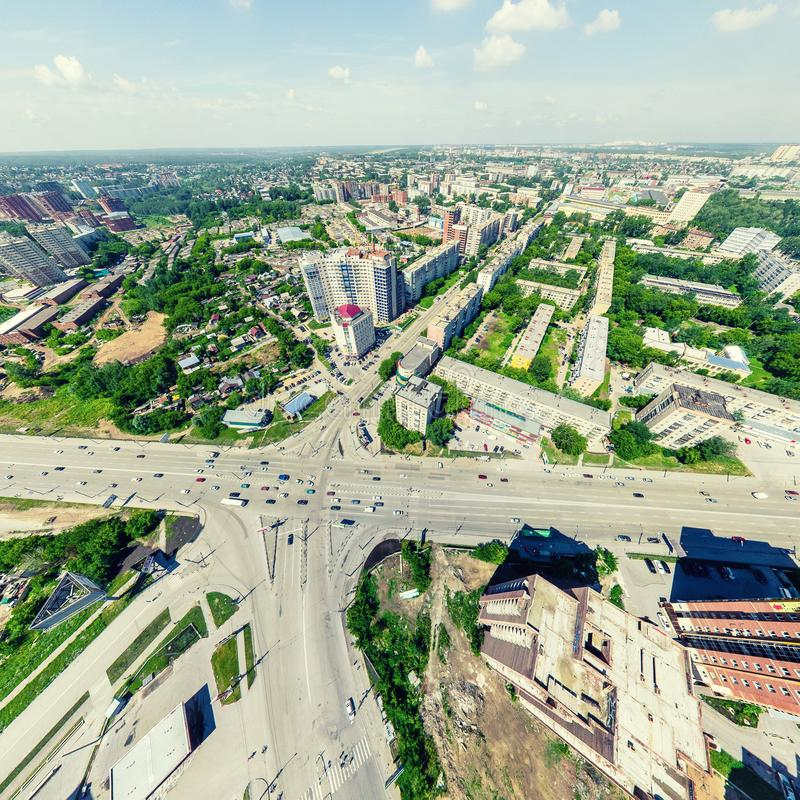 Aerial city view. Urban landscape. Copter shot. Panoramic image. Aerial city view with crossroads and roads, houses, buildings, parks and parking lots, bridges royalty free stock photo