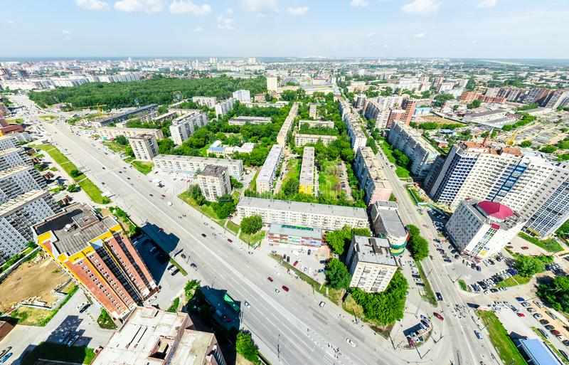 Aerial city view. Urban landscape. Copter shot. Panoramic image. Aerial city view with crossroads and roads, houses, buildings, parks and parking lots, bridges stock photo