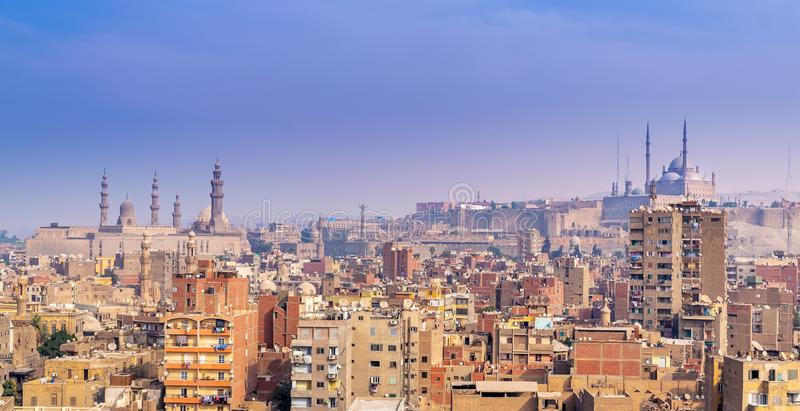 Aerial cityscape view of old Cairo, Egypt with Cairo Citadel and Sultan Hasan Mosque in far distance stock photos
