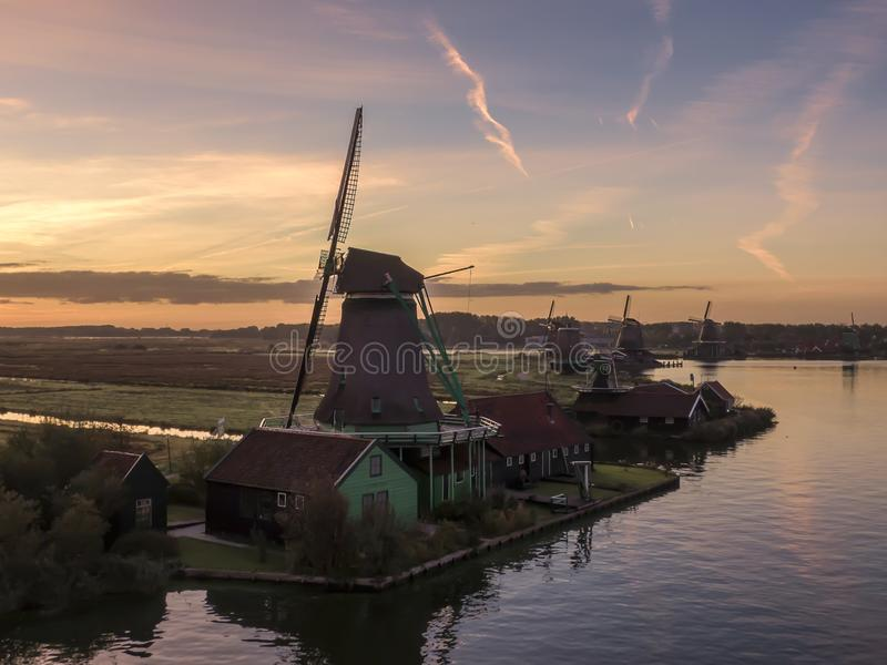Aerial of classic dutch windmills at the Zaanse Schans during a stunning sunrise stock image
