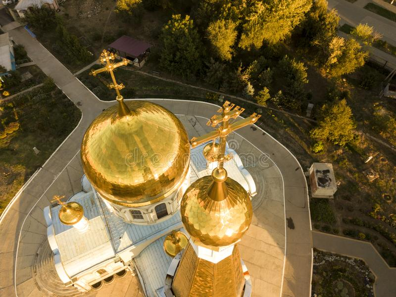 Aerial close up religion cross on top of amazing golden church architecture during sunset f royalty free stock photo