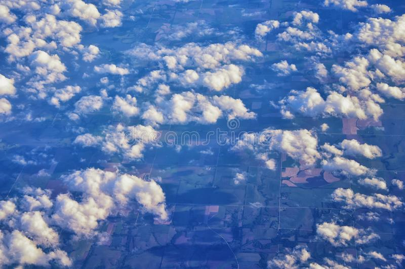 Aerial Cloudscape view over midwest states on flight over Colorado, Kansas, Missouri, Illinois, Indiana, Ohio and West Virginia du. Ring autumn. Grand sweeping stock image