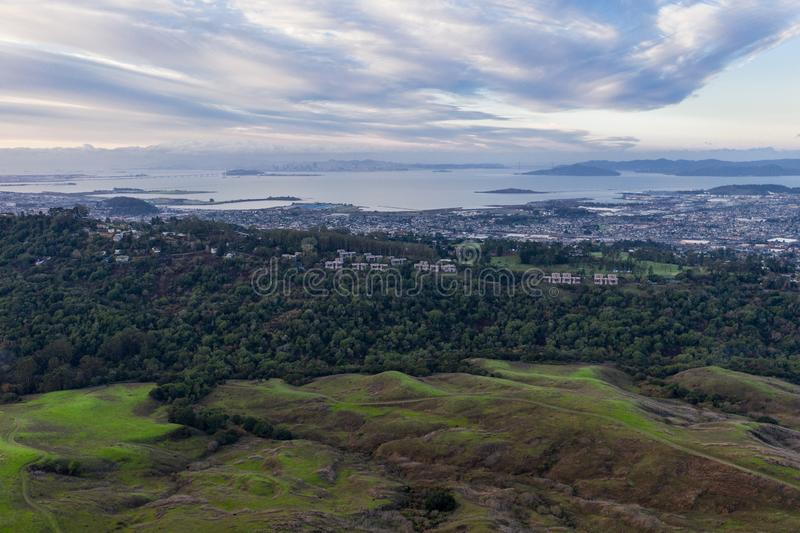 Aerial of Cloudy Sunrise and San Francisco Bay Area. Winter rains cause lush green grass and foliage to grow in the peaceful hills of the East Bay, just east of stock images