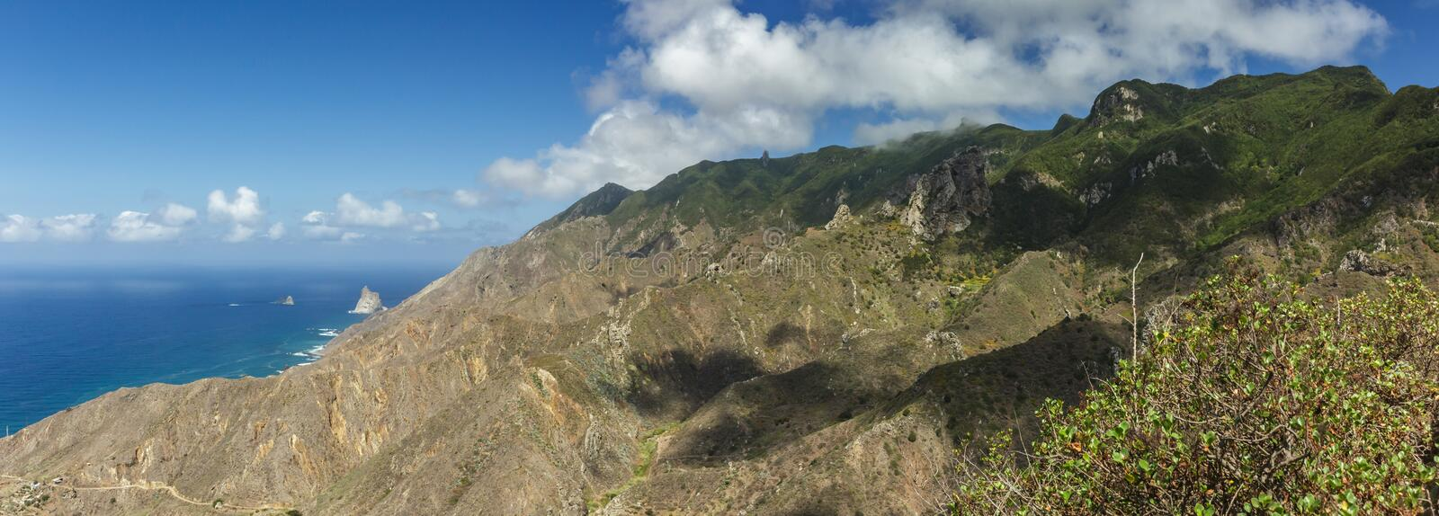 Aerial Coast view, mountain Anaga and costal village. Sunny day, clear blue sky with little fluffy white clouds. Oldest part of royalty free stock photos