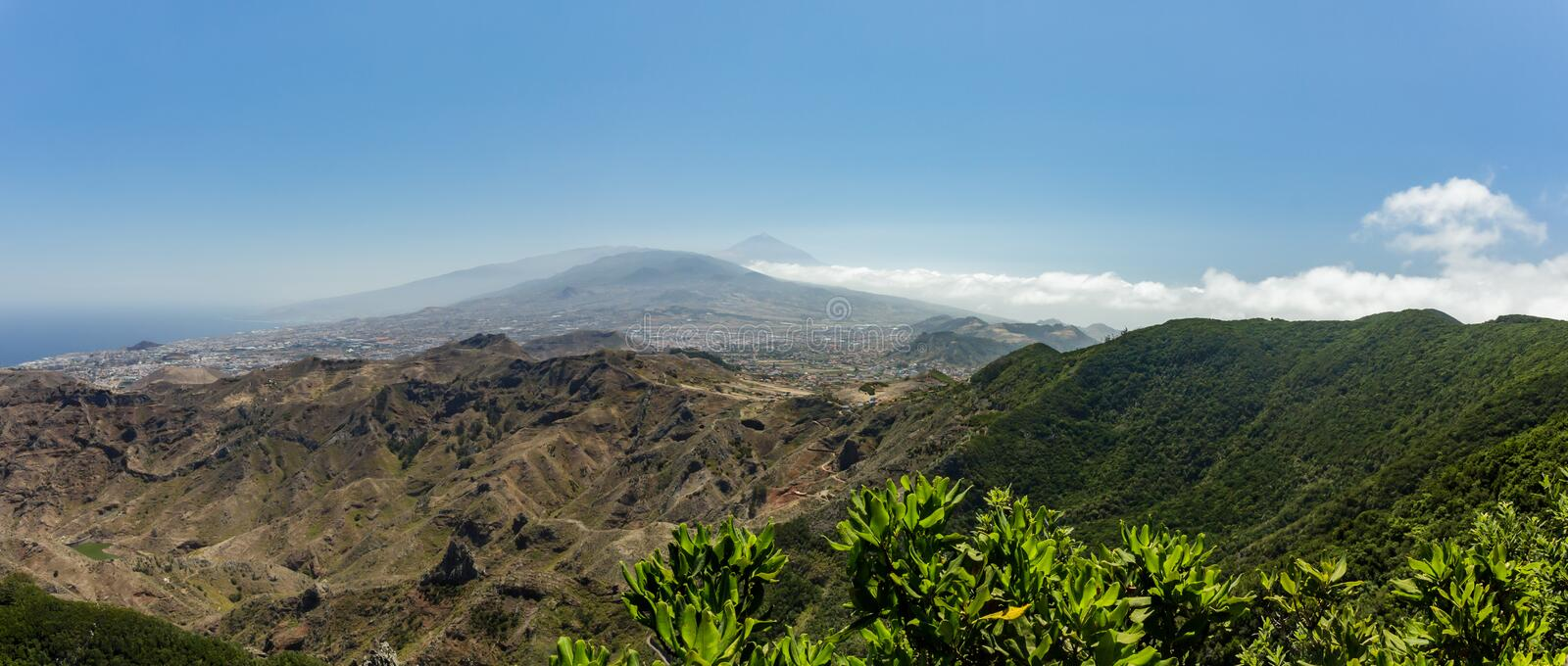 Aerial Coast view of mountains Anaga and La Laguna valley. Sunny day, clear blue sky with little fluffy white clouds. Oldest part royalty free stock images
