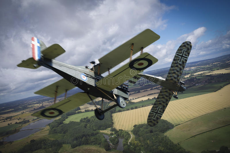 Aerial combat. Vintage WW1 planes in a dogfight stock images