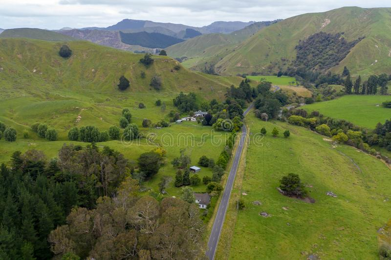 Aerial, Country Road through hills of New Zealand Countryside royalty free stock images