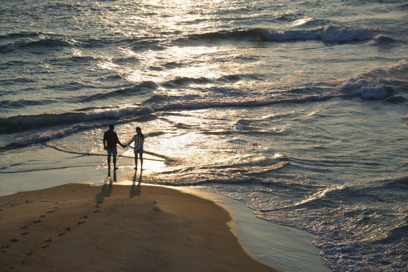 Aerial of couple on beach. stock photos